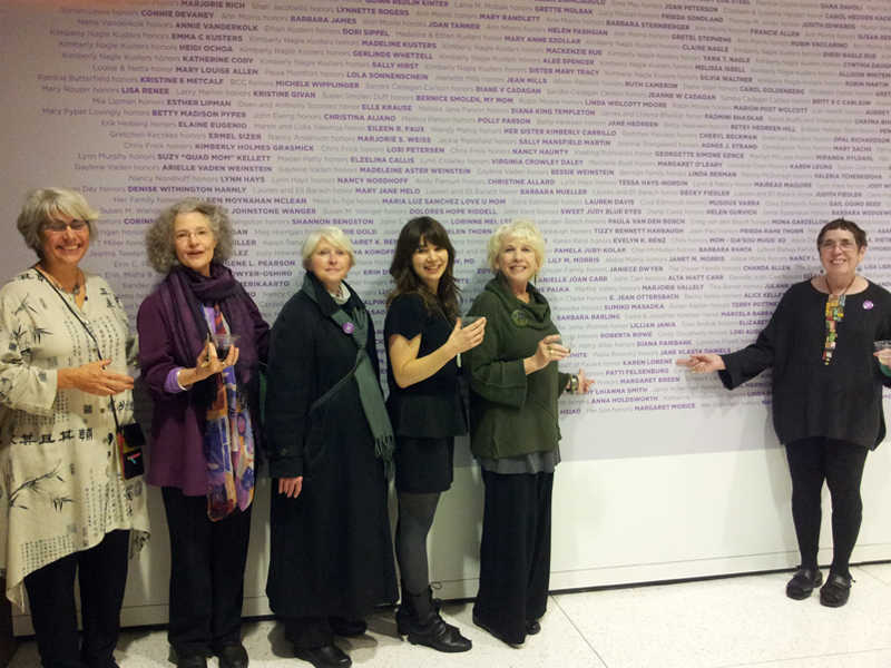 Facèré staff—(left to right) Nancy Mēgan Corwin, Dana Shaw, Susan Welch, Madeline Courtney (Maddy), Lorraine Vagner, and Karen Lorene—standing in front of the Seattle Art Museum's Wall of Women, 2012