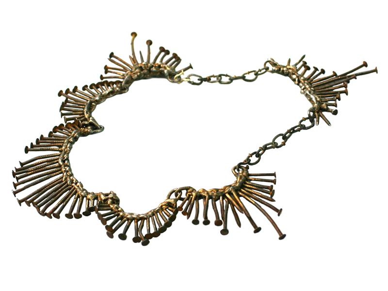 Nolia Shakti, Golden One, 2009, necklace, steel, iron, paint, rust, gold, 15 (smallest) x 100 (biggest) x 600 mm, photo: artist