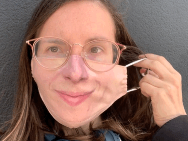 A still from a GIF showing a woman wearing a mask printed with her own features, courtesy of maskalike.com