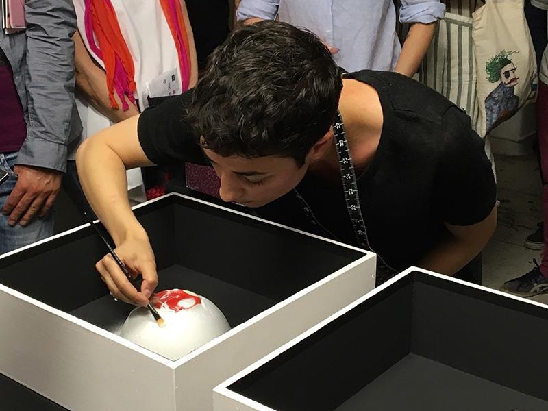 Artist Lodie Kardouss performing Curiosity #9